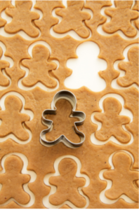 Cookie dough with gingerbread person cutter